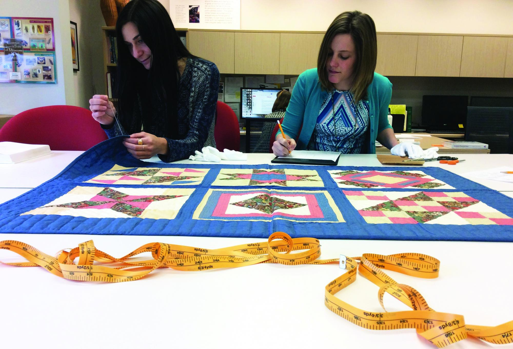 Ladies working on a quilt
