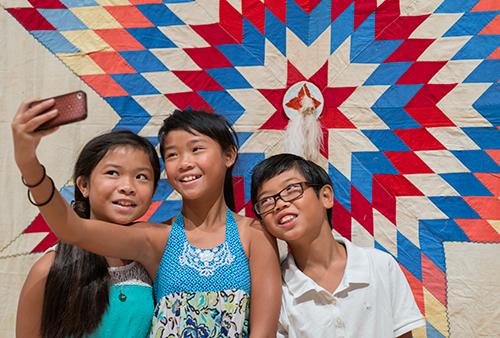 Children Photo with Quilt Exhibit