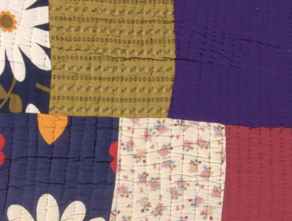 detail of scrappy patchwork quilt