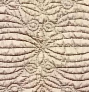 detail of pale purple wholecloth quilt